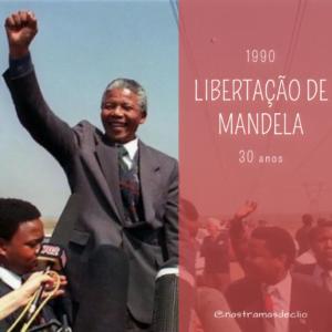 Nelson Mandela com o braço erguido, com a frase escrita: Libertação de Mandela.
